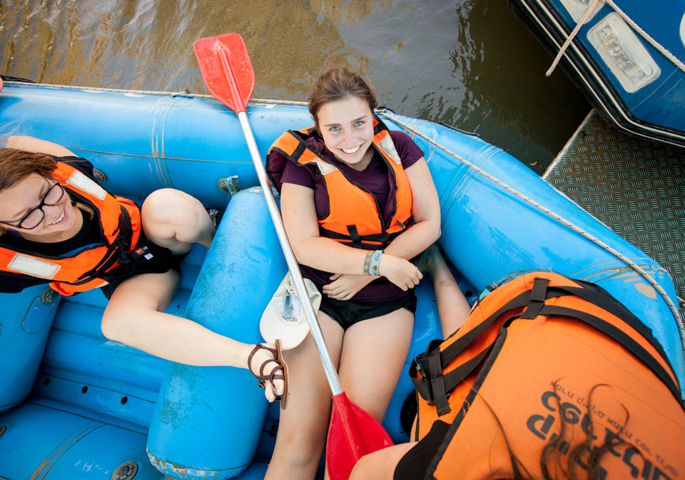Teen girls on inflatable raft