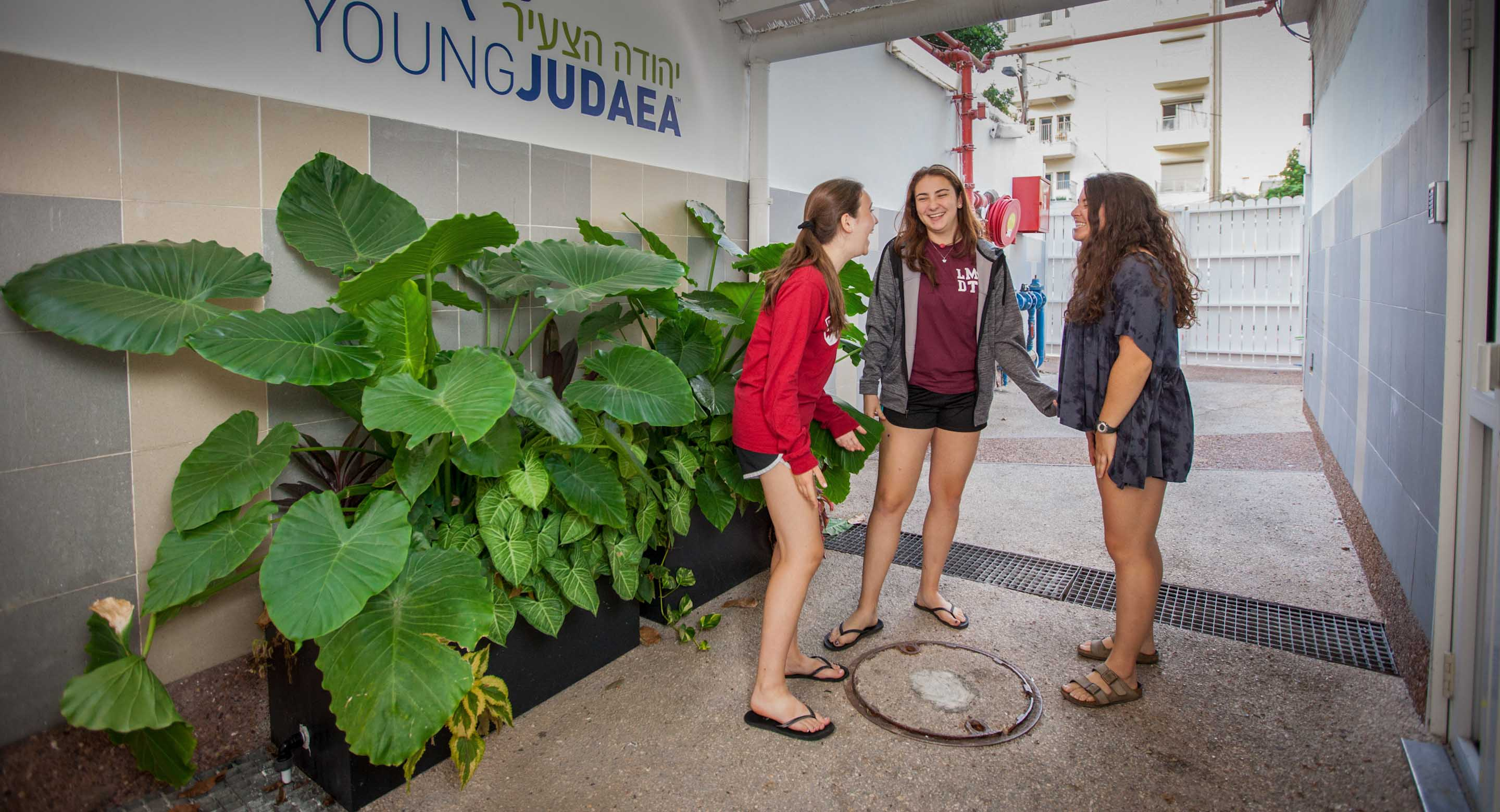 3 teen girls at Young Judaea entrance
