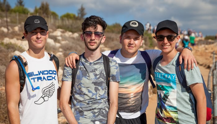 4 young men backpacking