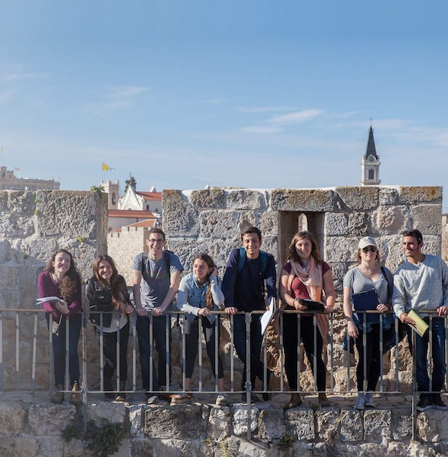 Young men and women on building in Israel